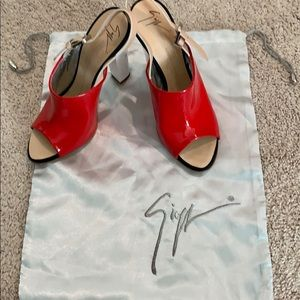 Red,White patent w/a tan leather strap NEVER WORN